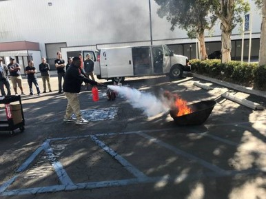 An ALS attendee gets hands-on experience extinguishing a live fire at our latest Advanced Line Service workshop in Long Beach, CA.